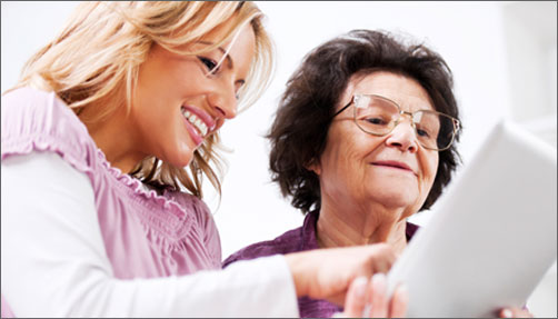 Caregiver reviewing paperwork with senior woman