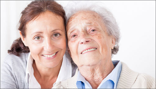 Woman smiling with her senior mom