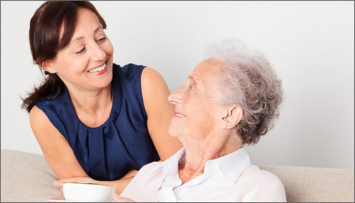 Caregiver smiling at senior